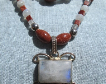 Goldstone, Rainbow Moonstone, and silver Triple strand adjustable necklace with large pendant