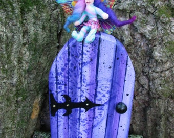 Enchanting Purple Faerie Door Garden Ornament for your tree trunk