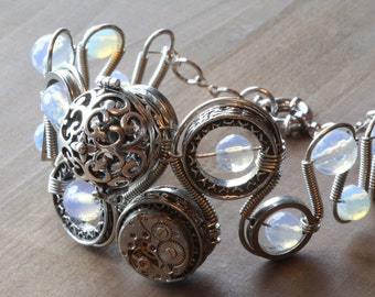 Steampunk bracelet with Opalite, watch movement with an essential oils or perfume diffuser.