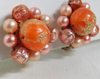 Vintage lucite cluster beaded earrings pink pearls, gold glitter and foil art beads, orange and blush gold tone clip on earrings Japan