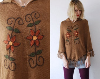 SALE...70s embroidered hippie poncho. knit cape with fringe - small, medium