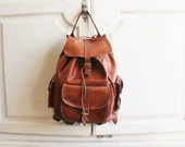 vintage 70s leather backpack distressed