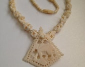 Carved Bone Elephant Necklace
