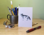 Coyote note card. Black line drawing of a coyote, with text on the back about coyote the trickster.  Send unique snail mail.