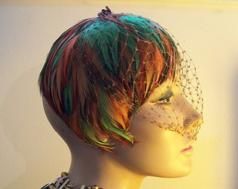 Vintage long feather fascinator 1960s original netting green and burnt sienna orange feathers.