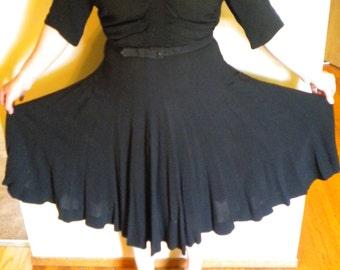 Vintage 1950s Black Ruched Swinging Rayon Crepe dress belted Very flattering