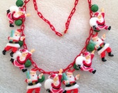 """RESERVED for Laurence - Early plastic Santa Claus """"Christmas"""" necklace - vintage findings"""