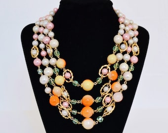 Vintage Necklace with Four Strands of Pink and Opalescent and Orange Beads Made in Japan