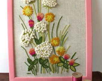 Vintage crewel embroidery wildflowers - Queen Anne's lace, pink clover, dandelions - 1970s needlework in pink frame