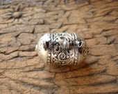 Moroccan  tarnished shiny very ornate  barrel bead with three loops