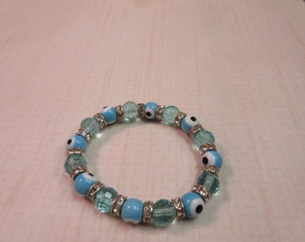 Turquoise Blue evil eye and clear glass beaded bracelet