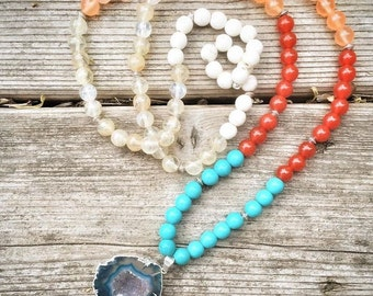 Yogi inspired 108 bead gemstone mediation mala necklace with turquoise carnelian, agate, quartz and a blue geode pendant