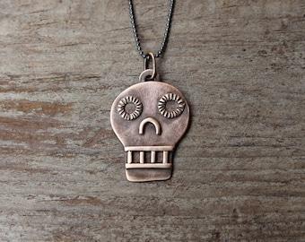 Bronze Calavera pendant #1
