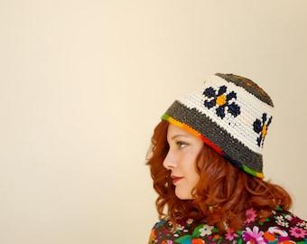 Vintage blue daisy knit stocking hat, rainbow floral wool winter crochet 1970s