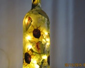 Wine bottle with Sunflowers and lights/hand painted