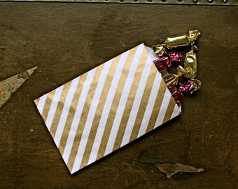 Party or wedding favor bags, set of 50 white kraft paper bags with gold diagonal stripe. Candy buffet, goodie bags, bitty bags.