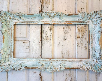 Soft blue picture frame wall hanging shabby French chic distressed faded cloudy colors gold accented ornate home decor anita spero design