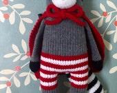 Handmade Knit Mischievous Caped Raccoon
