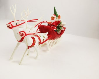 Vintage Holiday Santa Claus and Sleigh - Plastic From Hong Kong - Gold Spotted Deer - Santa With Reins - Gifts and Tree in Back