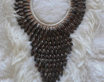 Papua Native Warrior necklace White feathers and brown  shells.