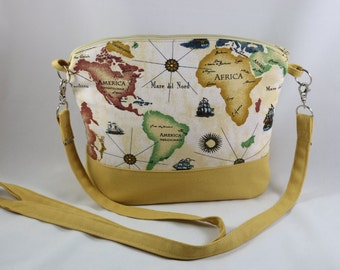 A mustard and beige, canvas cotton ,world map  print , arm/cross body purse.