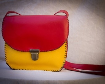 yellow and red leather bag