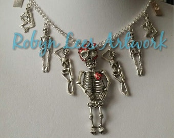 Party of the Damned Necklace with Skeletons, Dancing & Hanging Skeletons, Blood Red Rhinestone Skeleton and RIP Gravestones on Silver Chain