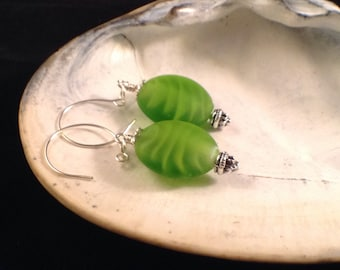E020, Gorgeous one of a kind beach glass dangle earrings wire wrapped and displayed on hand made ear wires...Stunning