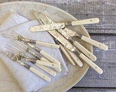 """Antique set of forks and knives with bone handles, monogrammed """"M"""""""