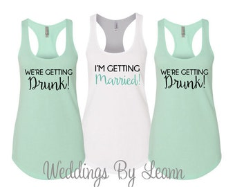 I'm getting married so We're getting drunk , Bachelorette Party Tank Tops, Bachelorette Party Shirts, Tank Tops