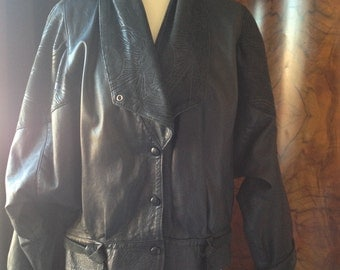 Vintage 1980's black leather jacket, retro style, adjustable collar, poppers and belt detail, 80's look, batwing sleeves
