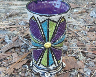 Purple, turquoise, and lime green quilt tumbler