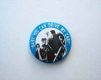 Large vintage Beatles plastic button 'baby, you can drive my car'