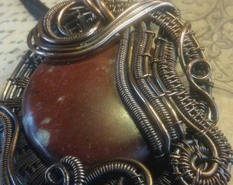 Waves pendant - Red jasper focal stone captured with copper wire weaves