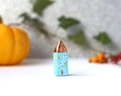 Little clay home - light blue house with leaves decoration and copper roof
