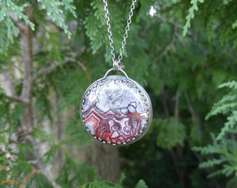 Crazy Lace Agate Sterling Silver Pendant. Large, Round Burgundy and Grey Agate. Wilderness Scene with Bear, Mountains and Tree on Reverse.