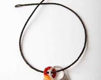 Tuareg silver and agate pendants on leather cord. Tenerelen