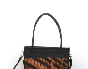 Leather dutch design shoulderbag with copper print