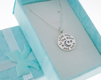 Love You To The Moon And Back Necklace in sterling silver on sterling silver box chain.  Love you to the moon and back necklace.