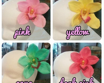 Single Cymbidium orchids pinup hair flower. Available in aqua, yellow, light pink and dark pink.