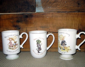 Set Of 2 vintage Holly Hobbie porcelain Coffee mugs or Tea Cups. Middle one has Sold