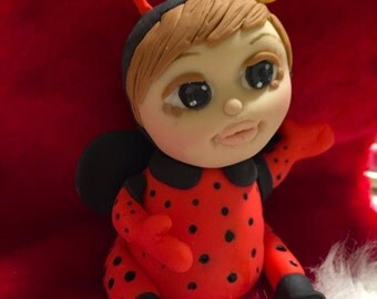 Baby in Ladybug Suit Cake Topper