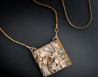 Sterling silver necklace, highly textured and riveted onto nu-gold, with a radiant cut clear Swarovski crystal