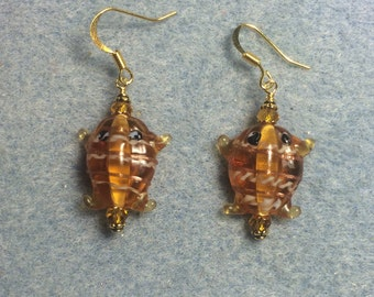 Amber lampwork frog bead earrings adorned with amber Chinese crystal beads.