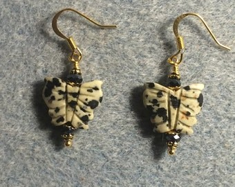 Dalmatian jasper gemstone butterfly bead earrings adorned with black Chinese crystal beads.