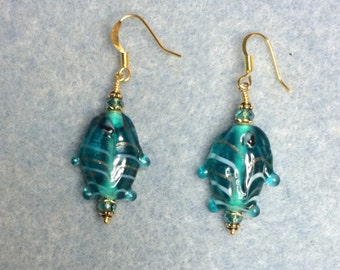 Teal transparent lampwork fish bead earrings adorned with teal crystal beads.