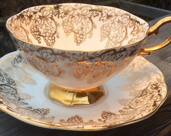 Gold and White Royal Standard China Footed Teacup and Saucer With Grapes