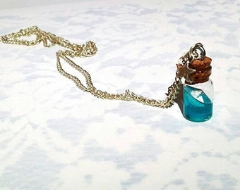 High seas. Tiny boat in a bottle  pendant