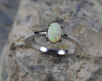 Lightning Ridge Solid White Opal with Green Blue Colors Sterling Silver Ring.