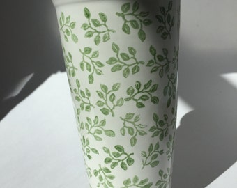 Ceramic travel mug hand decorated with green leaves